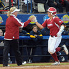 Sooner coach Patty Gasso congratulates Lauren Chamberlain on her homerun against Cal, Friday, June 1, 2012, in a second round game of the Womens College World Series at ASA Hall of Fame Stadium in Oklahoma City. Jerry Laizure/The Transcript