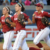 Oklahoma players Destinee Martinez, Brianna Turang and Erica Sampson rush from the outfield to join the celebration after Oklahoma defeated top-seeded Cal, Friday, June 1, 2012, in a second round game of the Womens College World Series at ASA Hall of Fame Stadium in Oklahoma City. Jerry Laizure/The Transcript
