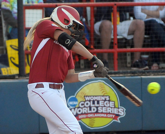 Jessica Shults makes contact with ball, Friday, June 1, 2012, in a second round game against Cal of the Womens College World Series at ASA Hall of Fame Stadium in Oklahoma City. Jerry Laizure/The Transcript
