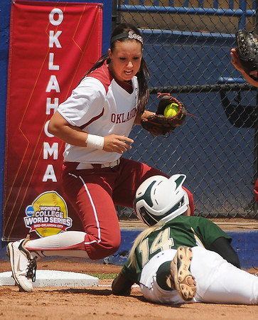 South Florida runner Jessica Mouse (14) is out at third after Oklahoma third baseman Javen Henson tagged her out in a run down, Thursday, May 31, 2012, in an opening round game of the Womens College World Series at ASA Hall of Fame Stadium in Oklahoma City. Jerry Laizure/The Transcript