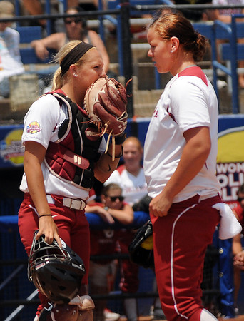 Oklahoma catcher Jessica Shults (left) and pitcheer Keilani Ricketts visit in the pitching cicle, Thursday, May 31, 2012, in an opening round game against South Florida in the Womens College World Series at ASA Hall of Fame Stadium in Oklahoma City. Jerry Laizure/The Transcript