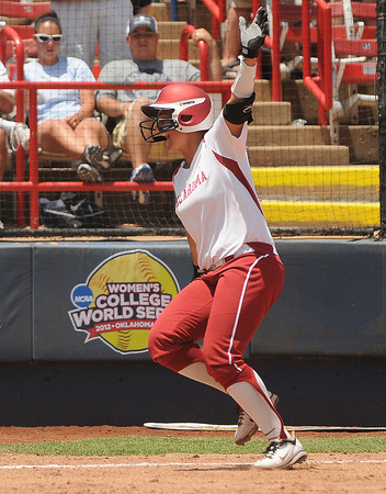 Oklahoma slugger Lauren Chamberlain celebrates her fourth inning homerun, Thursday, May 31, 2012, in an opening round game of the Womens College World Series at ASA Hall of Fame Stadium in Oklahoma City. Jerry Laizure/The Transcript