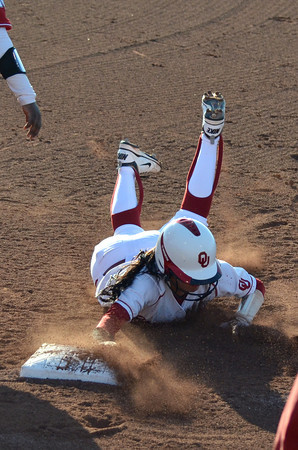 OU's Destinee Martinez dives into first, trying avoid being tagged out Saturday during the Sooners' game against Nebraska at Marita Hynes Field <br /> Kyle Phillips/The Transcript