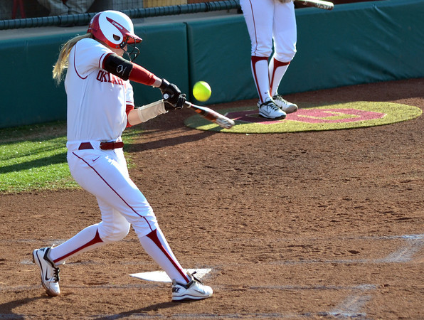 OU's Jessica Shultz makes contact with the ball Saturday during the Sooners' game against Nebraska at Marita Hynes Field <br /> Kyle Phillips/The Transcript