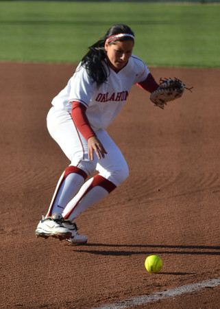 OU's Lauren Chamberlain picks up a ball to toss to first  Saturday during the Sooners' game against Nebraska at Marita Hynes Field <br /> Kyle Phillips/The Transcript
