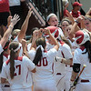 Oklahoma players celebrate a Katie Norris homerun against Arizona Friday, May 25, 2012, in the NCAA super regional being played at Marita Hynes Field in Norman. Jerry Laizure/The Transcript