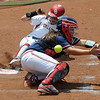 Oklahoma'sDestinee Martinez slides scores as the ball gets by Arizona catcher Chelsea Goodscre Friday, May 25, 2012, in the NCAA super regional being played at Marita Hynes Field in Norman. Jerry Laizure/The Transcript