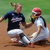 Oklaoma's Brianna Turang beats the tag of Arizona shortstop Shelby Pendley (21) Friday, May 25, 2012, in the NCAA super regional being played at Marita Hynes Field in Norman. Jerry Laizure/The Transcript
