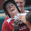 Oklahoma catcher Jessica Shults celebrates her homerun against Arizona Saturday, May 26, 2012, in the NCAA super regional being played at Marita Hynes Field in Norman. Jerry Laizure/The Transcript