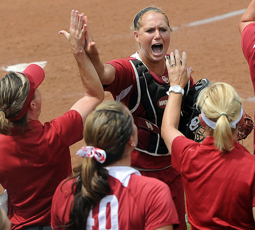Oklahooma catcher Jessica Shults gets a high five from assistant coch Melissa Lombardi Saturday, May 26, 2012, in the NCAA super regional game against Arizona being played at Marita Hynes Field in Norman. Jerry Laizure/The Transcript