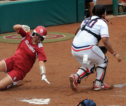 Oklahoma's Erica Sampson scores while Arizona catcher Lini Koria waits on the ball  Saturday, May 26, 2012, in the NCAA super regional being played at Marita Hynes Field in Norman. Jerry Laizure/The Transcript