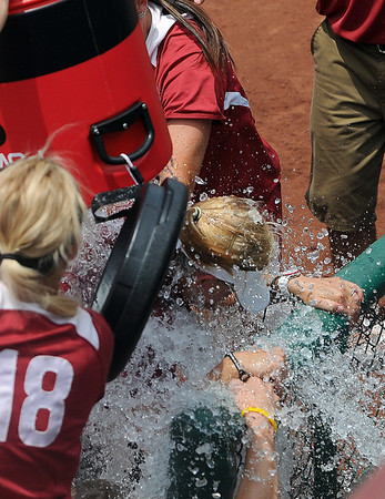 Oklahoma coach Patty Gasso gets a water shower Saturday, May 26, 2012, after the Sooners beat Arizona 7-1in the NCAA super regional being played at Marita Hynes Field in Norman. Jerry Laizure/The Transcript