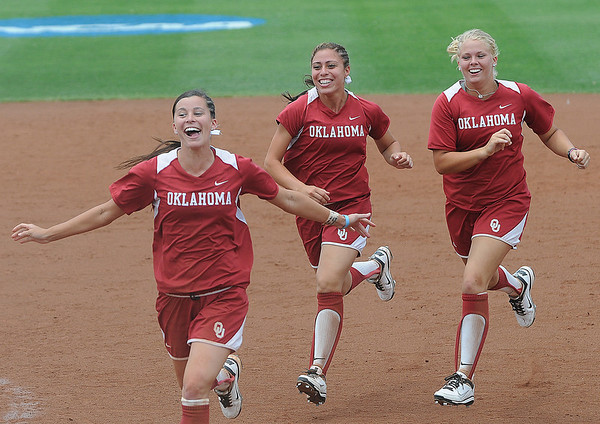 Oklahoma outfielders Brianna Turnag, Destinee martinez and Erica Sampson rush to join the celebration Saturday, May 26, 2012, after the Sooners defeated Arizona in the NCAA super regional being played at Marita Hynes Field in Norman. Jerry Laizure/The Transcript