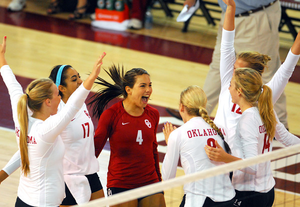 The Ou volleyball team celebrates after they score a point during their match against Kansas State Wednesday at the McCasland Field House. See the story on page B1. Kyle Phillips/The Transcript