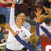 OU's Tara Dunn (12) spikes the ball  Wednesday during the Sooners' match against Kansas State at the McCasland Field House. <br /> Kyle Phillips/The Transcript