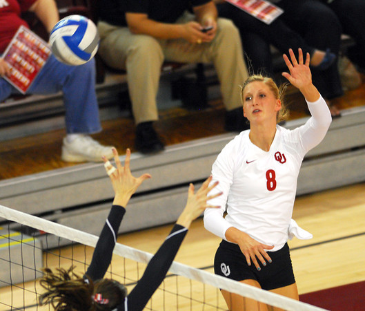 OU's Morgan Reynolds (8) hits the ball over the net  during the Sooners' match against Wichita State Wednesday at the McCasland Field House.  To see more photos from the game visit photos.normantranscript.com.<br /> Kyle Phillips/The Transcript