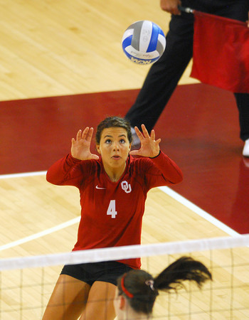 OU's Maria Fernanda (4) sets up her teammate for a spike during the Sooners' match against Wichita State Wednesday at the McCasland Field House.<br /> Kyle Phillips/The Transcript