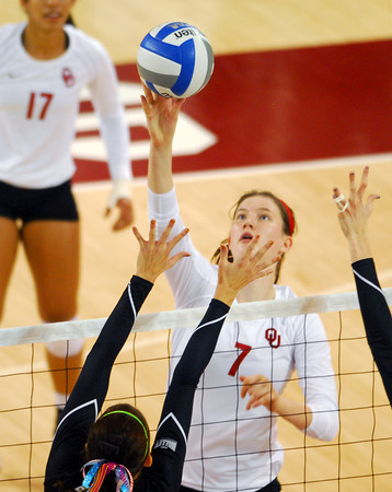 Oklahoma's Kierra Holst (7) taps the ball over the net during the Sooners' match against Wichita State Wednesday at the McCasland Field House.<br /> Kyle Phillips/The Transcript