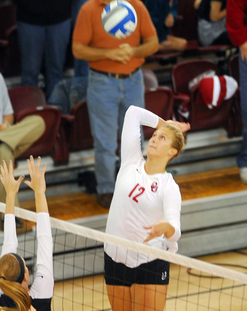 Oklahoma's Tara Dunn sets up to spike the ball during the Sooners' match against West Virginia Saturday night at teh McCasland Field House.<br /> Kyle Phillips/The Transcript