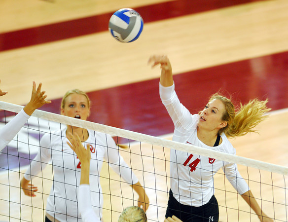 Oklahoma's Sallie 4McLaurin spikes the ball during the Sooners' match against West Virginia Saturday night at the McCasland Field House.<br /> Kyle Phillips/The Transcript