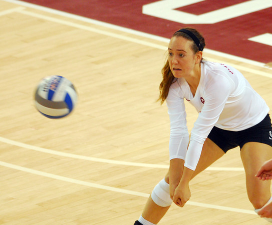 Oklahoma's Eden Williams sets the ball during the Sooners' match against West Virginia Saturday night at the McCasland Field House.<br /> Kyle Phillips/The Transcript