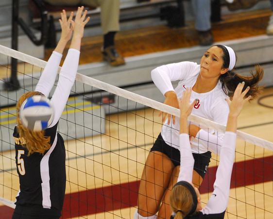 OU's Grace Whitley spikes the ball during the Sooners' match against West Viginia Saturday night at the McCasland Field House.<br /> Kyle Phillips/The Transcript