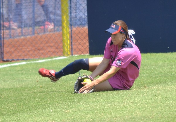 Team USA outfielder Kaitlin Cochran (9) slips as she tries to catch a flyball during Team USA's  game against the Netherlands Saturday afternoon at the ASA Hall of Fame Stadium.