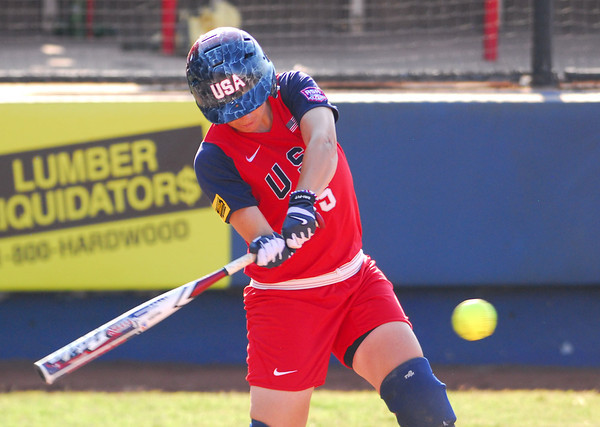 USA's Stacy May-Johnson connects with the ball during her turn at bat during USA's game against Team Australia Friday evening at the ASA Hall of Fame Stadium.<br /> Kyle Phillips/The Transcript