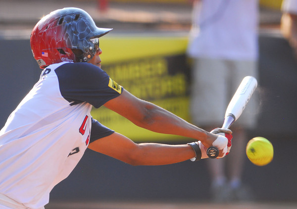Rhea Taylor makes contact with the ball during her turn at bat during Team USA's game against Puerto Rico Thursday afternoon. Team USA won the game 8-0.<br /> Kyle Phillips/The Transcript
