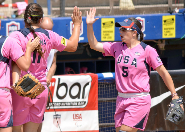 Jackie Traina (11) celebrates with Stacy May-Johnson (5) as Team USA comes off the field without letting any runs across the plate during their game against the Netherlands Saturday afternoon at the ASA Hall of Fame Stadium.<br /> Kyle Phillips/The Transcript