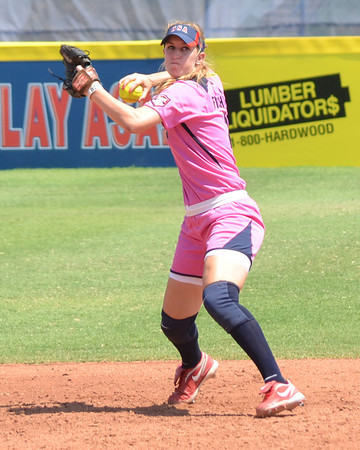 Samantha Fischer (2) rears back to throw the ball to first after she picks up a ground ball during Team USA's game  against the Netherlands Saturday afternoon at the ASA Hall of Fame Stadium.<br /> Kyle Phillips/The Transcript