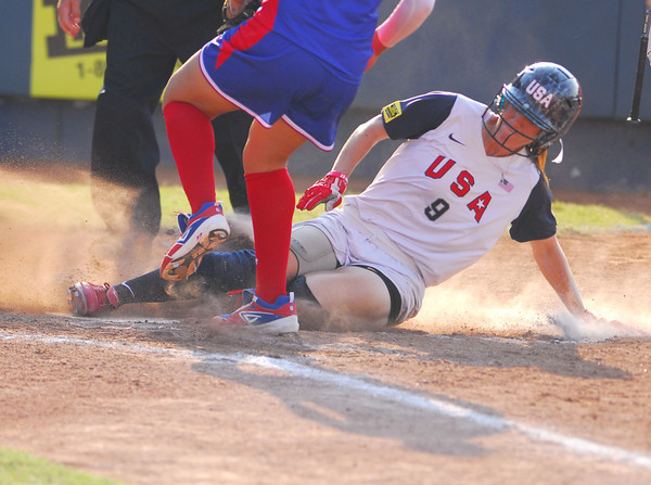 Kaitlin Cochran slides into home after a wild pitch allows her to score during Team USA's game against Puerto Rico Thursday night at the ASA Hall of Fame Stadium.<br /> Kyle Phillips/The Transcript
