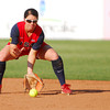 Team USA's Lauren Gibson (27) picks up a ground ball during her team's game against Team Australia Friday evening at the ASA Hall of Fame Stadium.<br /> Kyle Phillips/The Transcript
