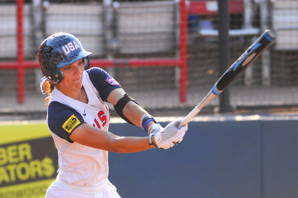 Christi Orgeron watches the ball after she gets a hit during Team USA's game against Puerto Rico Thursday at the ASA Hall of Fame Stadium.  Team USA won the game 8-0.<br /> Kyle Phillips/The Transcript