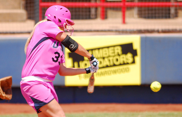 Jessica Shults makes contact with the ball during her turn at bat  as Team USA takes on  the Netherlands Saturday afternoon at the ASA Hall of Fame Stadium.<br /> Kyle Phillips/The Transcript