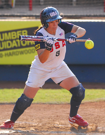 Stacy May-Johnson takes of for first base after getting a hit during Team USA's game against Puerto Rico Thursday at the ASA Hall of Fame Stadium.  Team USA won the game 8-0.<br /> Kyle Phillips/The Transcript