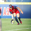 Team USA outfielder Kaitlin Cochran picks up a ground ball hit to the outfield Friday evening during USA's game against Australia at the ASA Hall of Fame Stadium.<br /> Kyle Phillips/The Transcript