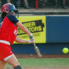 Team USA's Lauren Gibson makes contact with the ball during her team's game against Team Australia Friday night at the ASA Hall of Fame Stadium.<br /> Kyle Phillips/The Transcript