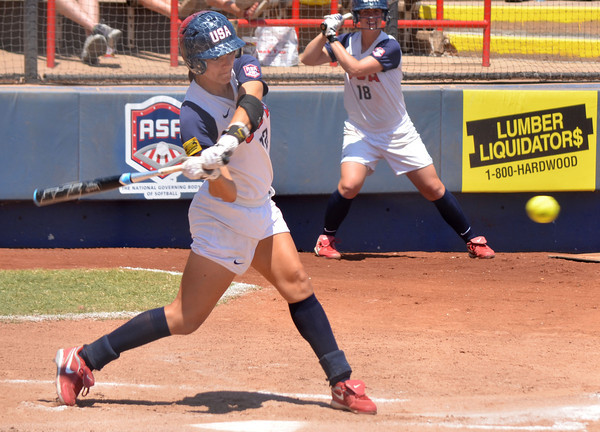 Christi Orgeron takes a swing at the ball during her turn at bat during Team USA's game against Team Brazil Sunday at the ASA Hall of Fame Stadium.<br /> Kyle Phillips/The Transcript
