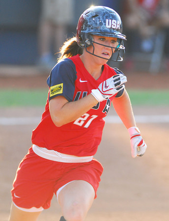 Team USA's Lauren Gibson rounds first base after getting a hit against Team Australia Friday night at the ASA Hall of Fame Stadium.<br /> Kyle Phillips/The Transcript