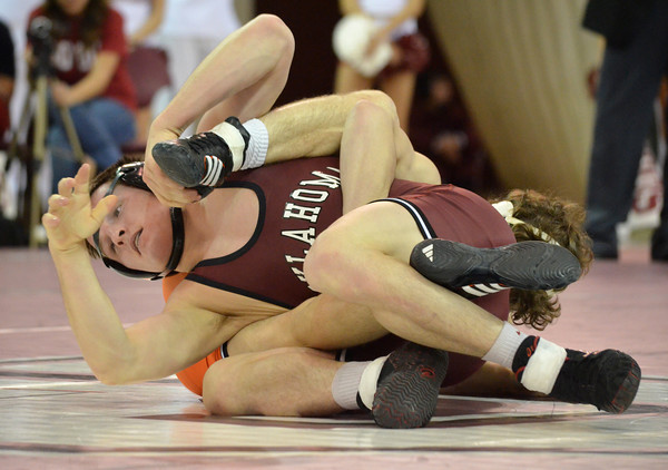 Oklahoma State's Jordan Oliver puts a hold on OU's Nick Lester  Sunday during the Bedlam wrestling match at the McCasland Field House at the University of Oklahoma.<br /> Kyle Phillips/The Transcript