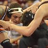 Oklahoma State's Jordan Oliver grapples with OU's Nick Lester  Sunday during the Bedlam wrestling match at the McCasland Field House at the University of Oklahoma.<br /> Kyle Phillips/The Transcript
