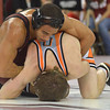 OU's Kendric Maple ties up Oklahoma State's Julian Feikert Sunday during the Bedlam wrestling match at the McCasland Field House on OU campus.<br /> Kyle Phillips/The Transcript