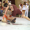 Oklahoma State's Jordan Oliver tries to pick up OU's Nick Lester Sunday during the Bedlam wrestling match at the McCasland Field House on OU campus.<br /> Kyle Phillips/The Transcript