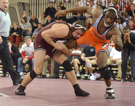 Oklahoma State's Chris Chionuma tries to break free from OU's Nolan McBryde Sunday during the Bedlam wrestling match at the McCasland Field House at the University of Oklahoma.<br /> Kyle Phillips/The Transcript