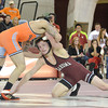 OU's Nick Lester lunges for Oklahoma State's Jordan Oliver Sunday during the Bedlam wrestling match at the McCasland Field House on OU campus.<br /> Kyle Phillips/The Transcript