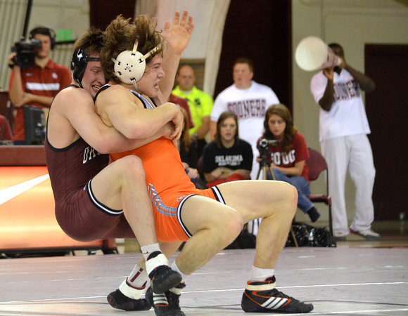 OU's Matt Lester tries to slam Oklahoma State's Alex Dieringer to the mat    Sunday during the Bedlam wrestling match at the McCasland Field House at the University of Oklahoma.<br /> Kyle Phillips/The Transcript