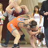 Oklahoma State's Jordan Oliver slams OU's Nick Lester to the mat  Sunday during the Bedlam wrestling match at the McCasland Field House at the University of Oklahoma.<br /> Kyle Phillips/The Transcript
