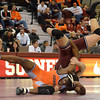 Oklahoma State's Chris Chionumaslams OU's Nolan McBryde to the mat Sunday during the Bedlam wrestling match at the McCasland Field House at the University of Oklahoma.<br /> Kyle Phillips/The Transcript