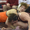 Oklahoma State's Alex Dieringer looks at his coach as he tries to put a hold on OU's Matt Lester  Sunday during the Bedlam wrestling match at the McCasland Field House at the University of Oklahoma.<br /> Kyle Phillips/The Transcript